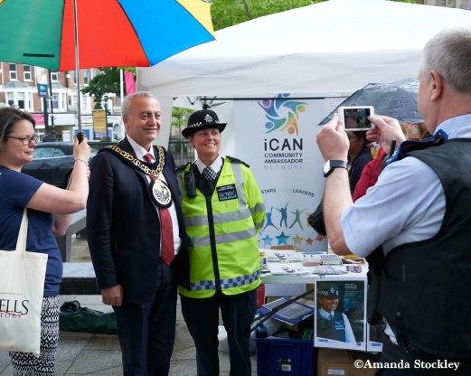 Mayor posing with police